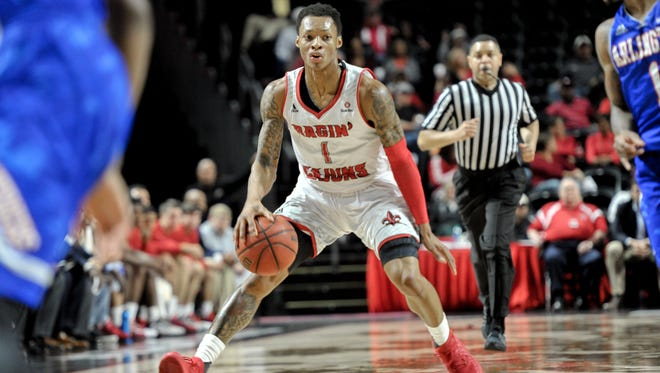UL point guard Jay Wright, shown here in Saturday's win over Texas-Arlington, was named Sun Belt Defensive Player of the Year on Monday.