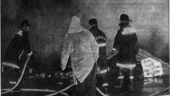 Firemen pour water on ruins of the Jolly Roger Haggle Shop after the devastating February 13, 1969 fire in Verona.