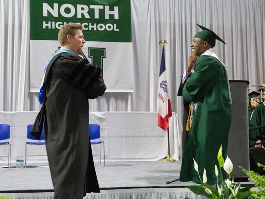 Superintendent Tom Ahart and North High senior Robert