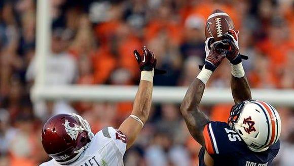 Auburn defensive back Joshua Holsey will return from