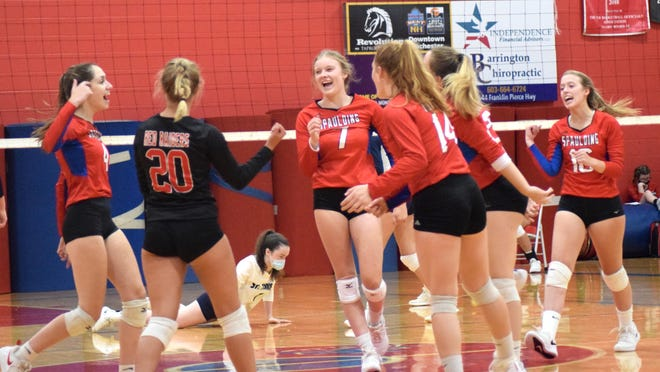 Spaulding High School volleyball players, including April Beatty (far left), Madi Heon .  (7) and Leah Hobbs (far right), react during the opening set of Monday's volleyball match against St. Thomas in Rochester. Spaulding won the season-opener, 3-0.