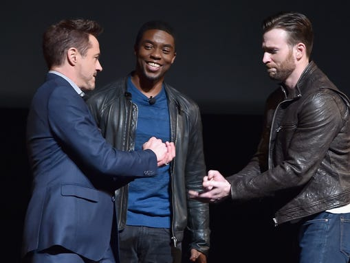Chadwick Boseman (center) is introduced to the Marvel