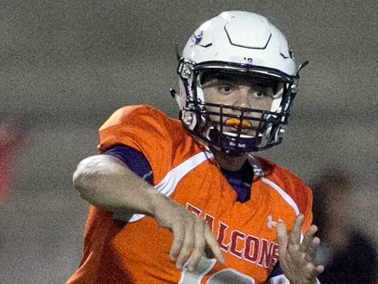 Eastlake quarterback Keith Tarango Lopez, 12, unloads a pass against Del Valle Friday night.