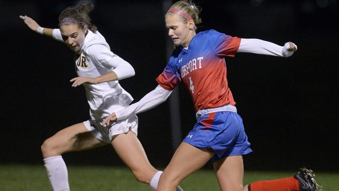 Victor's Abby Richards, left, defends against Fairport's Sinead Sargeant during a 2016 regular season soccer game at Victor High School.