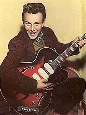"Charlie Gracie poses with his Guild guitar in 1957, the year his hit single ""Butterfly,"" was released by Cameo."