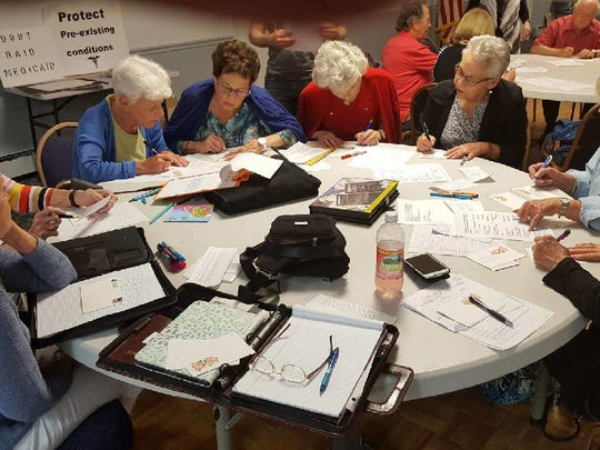 The Monroe chapter of Indivisible is mostly comprised of senior citizens, many of whom are engaging in politics for the first time in their lives. Pictured above, a group of women writing postcards to legislators urging them not to repeal the Affordable Care Act.