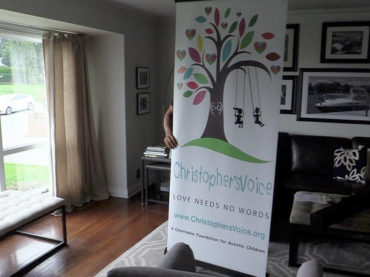 Chris Greco, co-founder Christopher's Voice, with their display in his New Rochelle home on Wednesday, August 2, 2017.