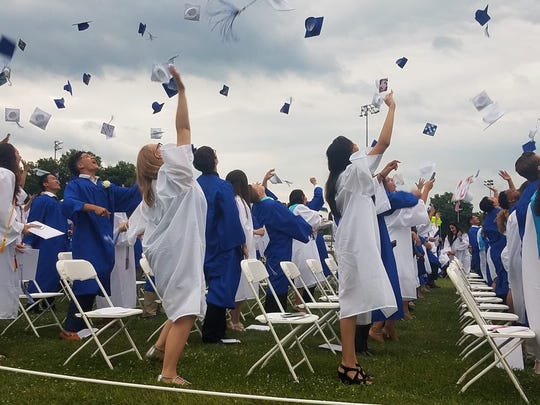 The Middlesex High School Class of 2018 celebrates their graduation at the school