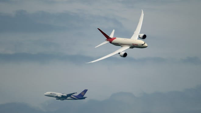 In this file photo from June 20, 2013, an Air India Boeing 787 Dreamliner fliers near an Airbus A380 of Thai Airways over Le Bourget airport during the 50th International Paris Air show. Thai is a founding member of the Star Alliance.
