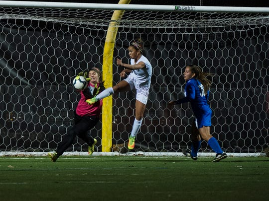 Fairfield's Anabel Anderson kicks the ball as Warrior Run's goalkeeper Madi Welliver attempts to block Tuesday Nov. 15, 2016 at Cumberland Valley School District during the PIAA semifinal soccer playoffs.