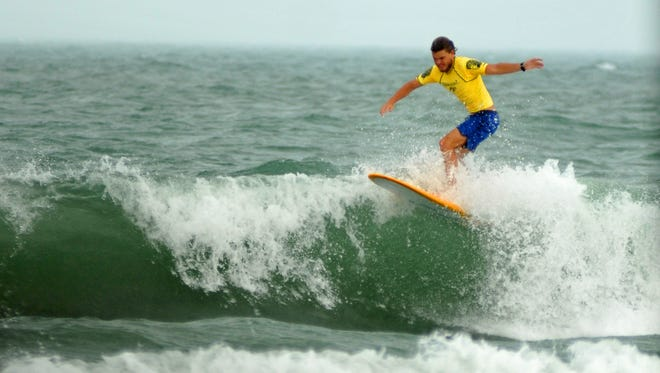 Fisher Grant competes in the finals of the NKF Rich Salick Pro/Am Surf Festival in September at the Westgate Resorts Cocoa Beach Pier.