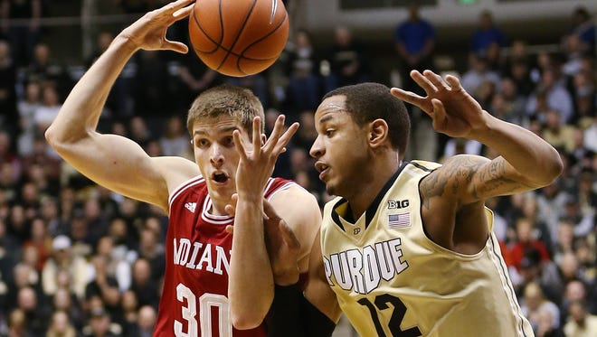 Indiana Hoosiers forward Collin Hartman battle Purdue Boilermakers forward Vince Edwards for a loose ball in the first half. Purdue hosted Indiana at Mackey Arena Wednesday, January 28, 2015.