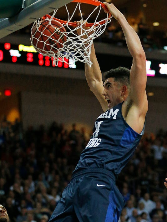 BYU center Corbin Kaufusi (44) dunks against Gonzaga during the second half of a West Coast Conference tournament NCAA college basketball game Monday, March 7, 2016, in Las Vegas. (AP Photo/John Locher)