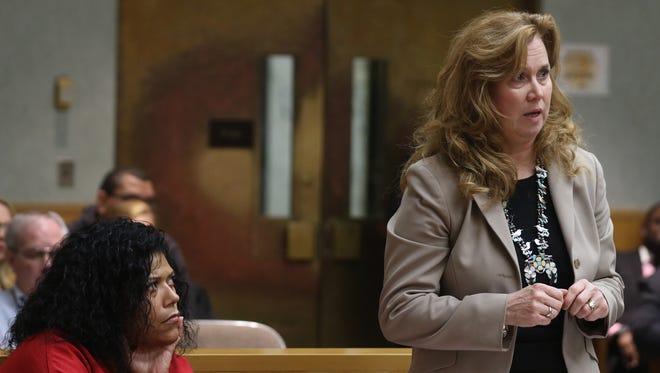 Judge Leticia Astacio watches Bridget Field and the judge discuss the plea.