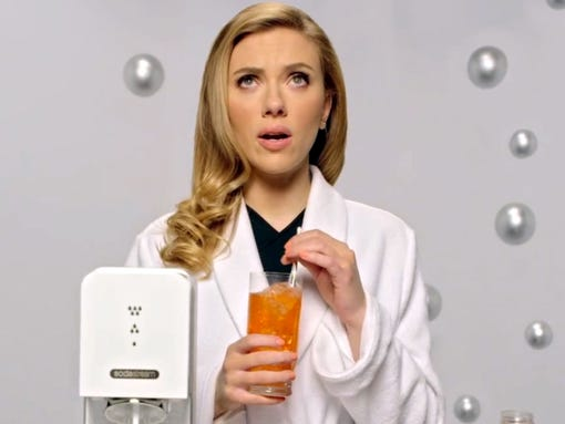 This undated frame grab provided by SodaStream, shows the company's 2014 Super Bowl commercial. SodaStreamÕs ad features ÒHerÓ actress Scarlett Johansson promoting its at-home soda maker and will run in the fourth quarter. The ad, which promotes the product as a healthier and less wasteful way to make soda, made waves ahead of the game when the company said it would delete itÕs last line, ÒSorry, Coke and Pepsi,Ó at a request by Fox. (AP Photo/SodaStream)