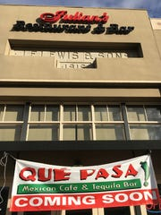 """A """"coming soon"""" banner for Que Pasa Mexican Cafe & Tequila Bar is seen at what closed in November as Julian's Restaurant & Bar."""