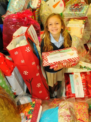 Madison King, 7, got her school, Pinapple Cove Classical Academy and the students at Lockmar Elementary School to write 1,500 Christmas cards to seniors who will get presents through FLORIDA TODAY's Reaching Out Holiday Fund and a partnership with Aging Matters in Brevard.
