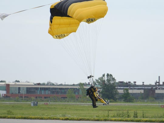 Rex Ryan touches down after jumping out of a plane with the United States Army Golden Knights Parachute Team on July 17, 2015.