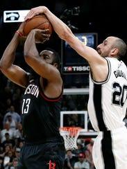 San Antonio Spurs guard Manu Ginobili blocks Houston