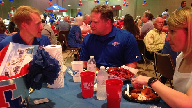 """Louisiana Tech men's basketball coach Eric Konkol (left) talks with Lady Techster coaches Scott and Brooke Stoehr Friday night at the Bossier Civic Center during """"Tech & Tails 9."""""""