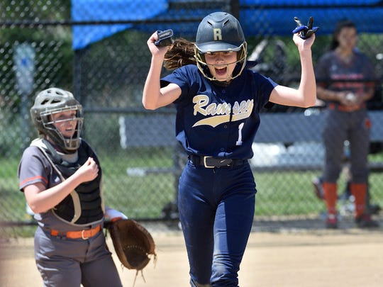 Ramsey's Emma Cunningham celebrates a run in the game against Dumont at the Bergen County softball tournament semifinals in Overpeck Park.