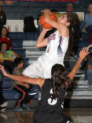 Sophomore Lady Cat guard Valerie Lopez led the Deming High varsity to a 63-36 home victory over the visiting Chaparral High Lobos Tuesday. Lopez pumped in a game-high 19 points.