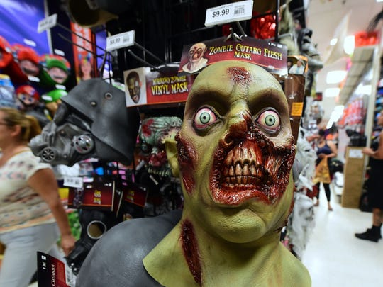 people shop for halloween items at a store in alhambra