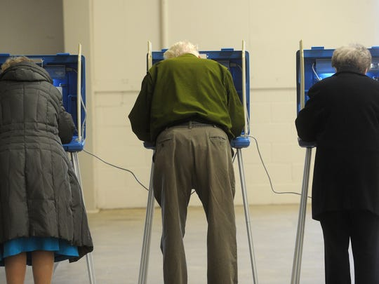 Voters fills out ballots at the polls in the expo center located at the Fond du Lac County fairgrounds.