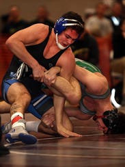Middlesex's Jeff Johnson (left) wrestles South Plainfield's