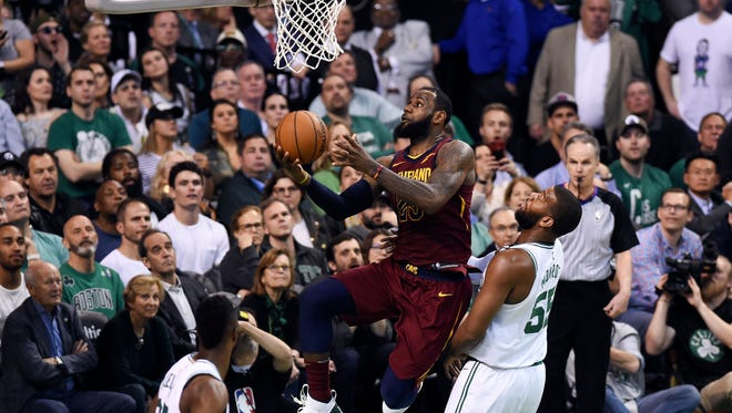 Cleveland Cavaliers forward LeBron James (23) attempts a layup in front of Boston Celtics center Greg Monroe (55) during the forth quarter in game two of the Eastern conference finals of the 2018 NBA Playoffs at TD Garden.