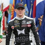 Cole Whitt, left, and 50 Cent hung out on the grid before the 2014 Daytona 500.