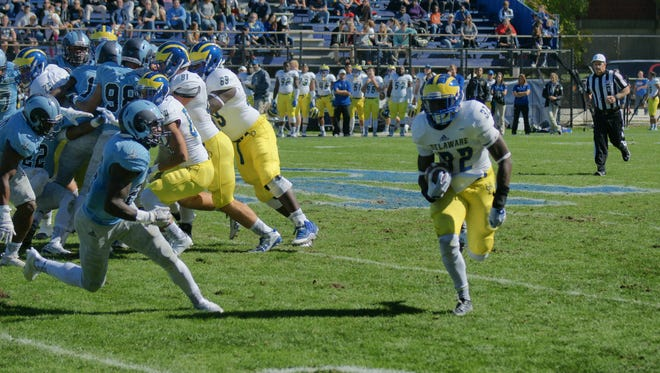 Delaware running back Kareem Williams tries to get around left end during the Blue Hens' 20-0 loss at Rhode Island in 2015.