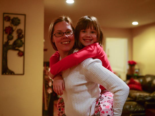 Melanie Hicks and her daughter Ava Vidovich, 8, at
