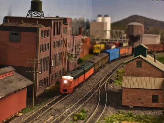A model freight train on its way to Maybrook is shown