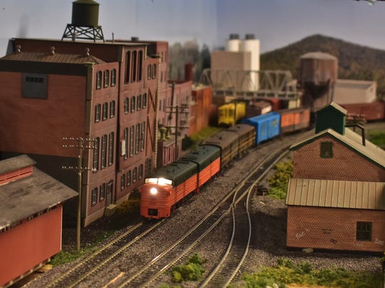 A model freight train on its way to Maybrook is shown heading into Poughkeepsie in David Todd Magill's basement display.