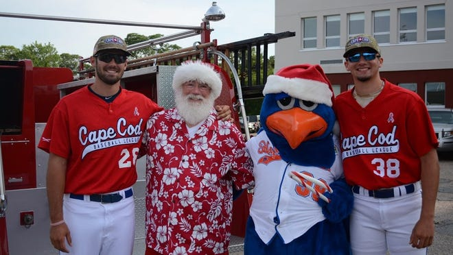 Harbor Hawk players and Ozzie welcome Santa to the 2019 Christmas in July celebration.