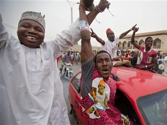 Supporters of opposition candidate Muhammadu Buhari celebrate in Kano, Nigeria, on Tuesday, March 31, 2015. President Goodluck Jonathan called his challenger to concede, defusing tensions and the possibility for a repeat of election violence.