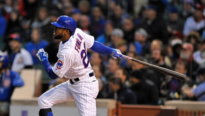 Chicago Cubs' Dexter Fowler watches his double during the first inning of a baseball game against the Cincinnati Reds Wednesday, April 13, 2016, in Chicago. (AP Photo/Paul Beaty)