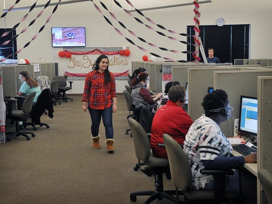 Sarah Quigley, call center director at USA800 in Wichita Falls, walks among the agents taking inbound customer service calls.