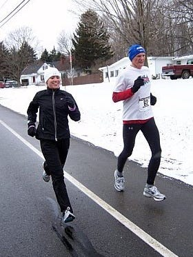 Jen Davenport Malik, 35, left, and her dad, David Davenport, 63, are regular participants in the Greater Rochester Track Club's winter Freezeroo Series. Jen was women's champ last year and David was third in the male 60-64 division.