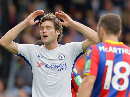 Chelsea's Marcos Alonso gestures after missing a chance on goal during their English Premier League soccer match between Crystal Palace and Chelsea at Selhurst Park stadium in London, Saturday, Oct. 14, 2017. Palace won the game 2-1. (AP Photo/Alastair Grant)
