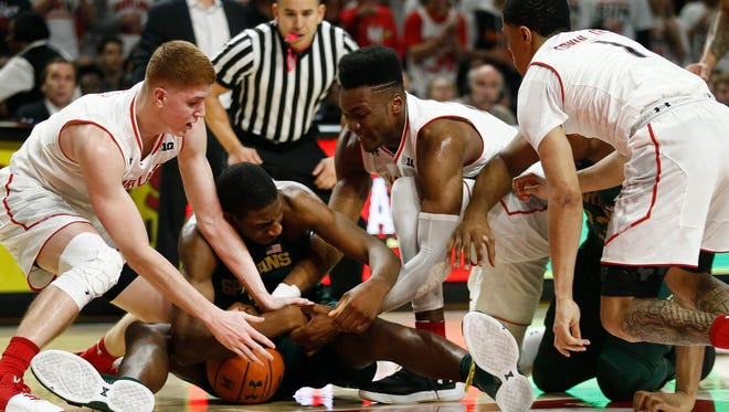 Michigan State's Jaren Jackson Jr. battles with players from Maryland for a loose ball during the first half of MSU's game Sunday in College Park, Maryland.