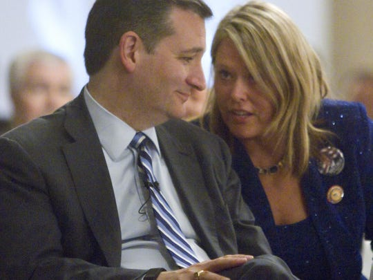 Wendy Day, campaign co-manager for GOP presidential candidate Ted Cruz for the state of Michigan, sits with Cruz before he takes the podium at the annual Lincoln Day Dinner.