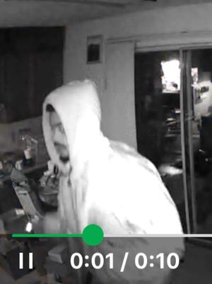 One of the suspects in the Lawrence home burglary was caught on a security camera.