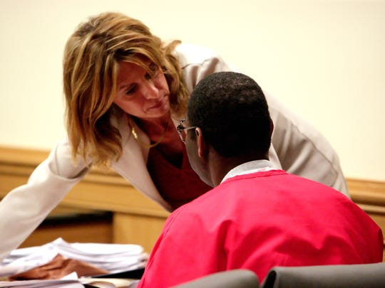 Investigator Sue Gent talks with J.B. Parker on March 6, 2008, in the Martin County Courthouse in Stuart. Parker is one of four men convicted of the April 2, 1982, murder of Julia Frances Slater, who was kidnapped shortly before midnight while working at a convenience store on U.S. 1 in north Stuart.