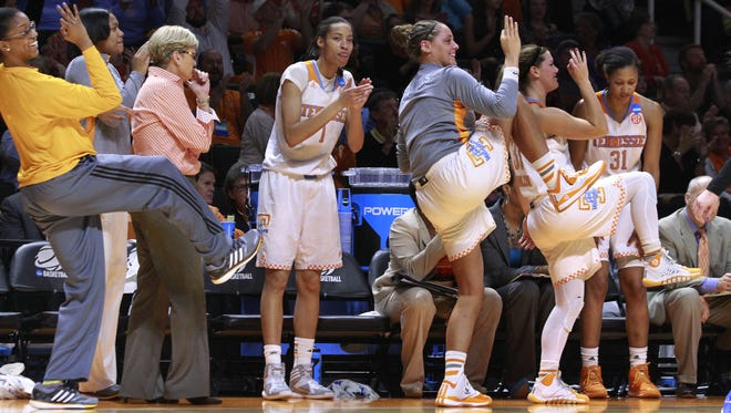 Players on the Tennessee bench celebrate a 3-point shot late in the game to help seal the 72-61 win over Boise State.