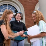 Same-sex couple Shelley Cranford, left, and Shannon Smith, right, exchange wedding bands during their marriage ceremony by pastor Brandiilyne Dear on the steps of the Forrest County Courthouse Monday afternoon. The two were denied their marriage license on Friday after other same-sex couples where married do to the change of The Supreme Courts law. They finally were able to receive their license Monday and proceeded with a marriage ceremony.