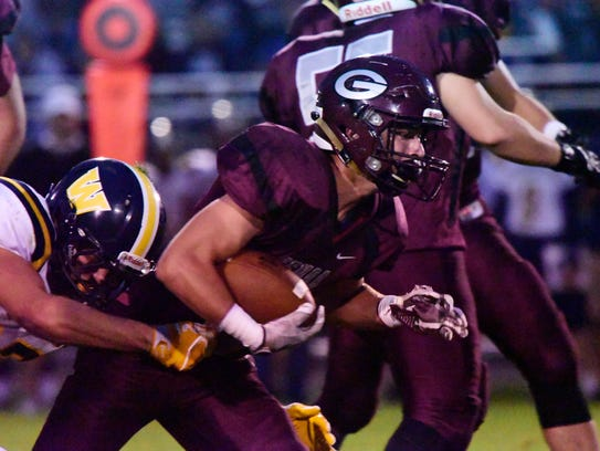 Genoa's Noah Edwards has rushed for at least 200 yards in five games this season.