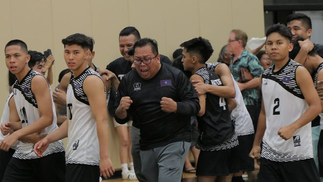 Tiyan High School Head Coach Rodney Pama celebrates with the team after beating Harvest in the IIAAG High School Boys Volleyball League semifinals.