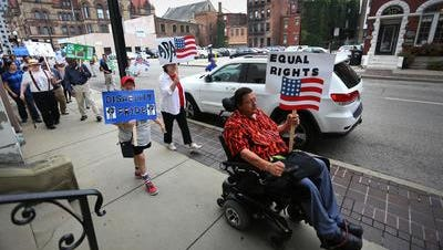 More than two dozen agencies and hundreds of community members participated in a disability pride walk from City Hall to Fountain Square, commemorating the 25th anniversary of the Americans with Disabilities Act (ADA). The walk was to celebrate the ADA, but also raise awareness of its limitations, where more work cane be done regarding disability rights.